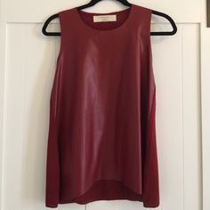 Faux leather-front top Burgundy faux leather-front sleeveless shirt. Makes an easy going out top when paired with jeans, heels or booties, and statement necklace! Made of 100% polyester. Zara Tops Tank Tops