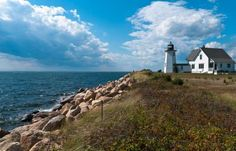 A coastal daytime view of a Cape Cod Lighthouse - Kenneth Wiedemann/Getty Images
