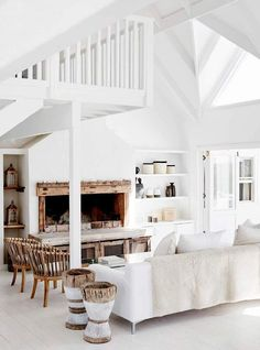 A stunningly beautiful home in Grotto Bay, South Africa, set on a headland with amazing views over the ocean. All white and weatherboard, with vaulted ceilings and white wood floors, and natural timber and cane accents for the light-filled interiors … it has that perfect relaxed contemporary holiday house look | design Logo Homes, photos by …
