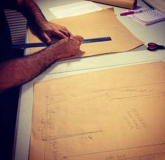 One of our students learning how to draft patterns.