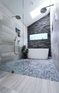 Would like this idea behind tub in white granite or something similar...marble?