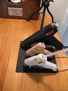 Keep your hot glue guns on a silicone oven hot pad. When the glue drips out...it's easy clean up.