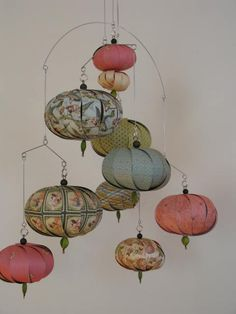 hanging lantern mobile - not only would these be fun to make for decor but I am pinning this too to use as artwork for notecards ... wish the lanterns had been centered in the photo.