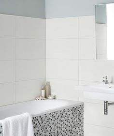 These white gloss tiles from our Timeless Neutrals™ range will help create a minimalist aesthetic in your home. The rectangular tiles have been designed with a straight edge so that a thinner grout line is needed, resulting in a smooth, modern finish. White Wall Tiles, White Bathroom Tiles, Bath Tiles, Loft Bathroom, Bathroom Flooring, Bathroom Ideas, Downstairs Bathroom, Bathrooms, Family Bathroom