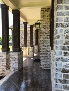 german smear mortar on a dark brick is a great look! Summit Brick's Andiron or Ebony would look amazing Brick Columns, Brick Facade, Brick Houses, Brick Siding, Porch Columns, Concrete Houses, D House, House With Porch, Exterior House Colors