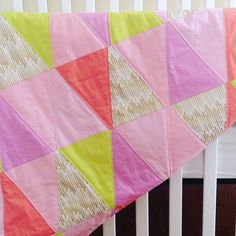Found this pic in the archives...my youngest daughter's baby quilt I made while I was still pregnant.  It's one of my favorite things I've made. Now it cuddles her at night.   #seekatesew #quiltpattern #trianglequilt #babyquilt #sewing #quilts #quilting #sewingforbaby