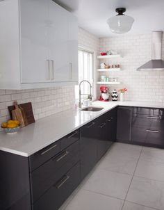 White subway tile + modern black kitchen cabinets