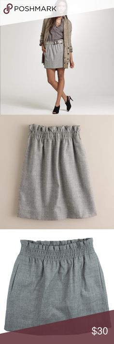 "JCREW Heather Gray Wool Bell Skirt Excellent condition! This heather gray wool bell skirt from JCREW features an elastic banded waist and is fully lined. Made of a wool blend. Measures: waist: 24-30"" (stretches), hips: 35"", total length: 15.5"" J. Crew Skirts Mini"