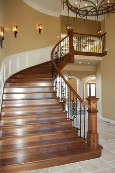 Custom Walnut Stair w/ wrought iron rails RL Builders Custom Luxury Homes – staircase Wrought Iron Staircase, Staircase Railings, Curved Staircase, Wood Stairs, House Stairs, Staircases, Staircase Ideas, Banisters, Villa Plan