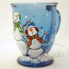 Creative Hand Two Snowmen Hand Painted Glass Mug: Share this snowman mug with your friends for that perfect drink of coffee, hot chocolate or tea. Each hand painted cobalt blue mug has two snowmen. Hand wash. Each hand painted glass may vary slightly from photo.    Price: $11.95