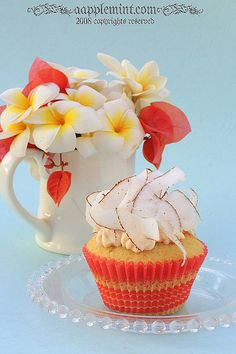 Tropical coconut cupcake with papaya cheesecake frosting and topped with caramelized papayas
