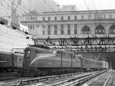 passes through the open area between New York City's General Post Office and the east portal of the Hudson River tubes as it departs Penn Station in the Electric Locomotive, Steam Locomotive, 30th Street Station, Motor Generator, Pennsylvania Railroad, Electric Train, Train Pictures, Photo On Wood, Empire