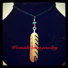 New feather charm hand wire wrapped with a little turquoise nugget and 2 red white hearts. Finished and ready for sale!  Wsljewelry@hotmail.com