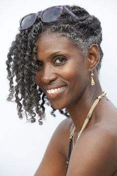 Mature, beautiful & gorgeous natural hair. I'm going be there one day.