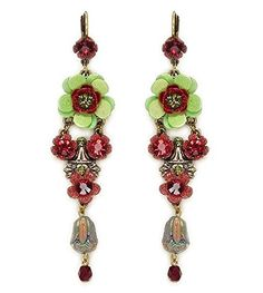 Exciting earrings - beautifully designed by Orly Zeelon with crystals, beads and hand painted flowers - handmade in Israel. This earring set is reminiscent of blossoms and spring. The center flower is comprised of multiple layers of petals which are arranged at various angles to create a dimensional look. The flower is accented with a stone center. Two small flowers in dazzling colors connect the center flower to a beautifully hand crafted platform.  Earrings length: 7.4 cm Earrings…