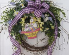 """Easter Wreath, Spring Wreath, Front Door Wreath, Grapevine Wreath, Handmade Wreath, Custom Wreath.  Here we have a luxurious Easter wreath that really pops on a door or wall featuring an adorable antiqued Easter bunny holding a sign that says """"Happy Easter"""" with lots of pretty coral and yellow wildflowers, gorgeous coral and white tulips that look so real and beautiful white delphiniums surrounded lush budding greenery and the bow is a coral fringed cotton on a grapevine wreath base. The…"""