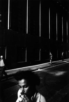 "trent parke - ""office workers light up cigarettes on their way to town hall train station after finishing work for the day. sydney, australia 1999"" (from ""dream/life"" series)"