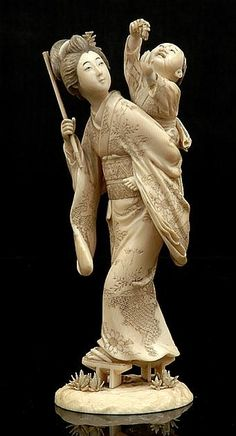 A Japanese carved ivory okimono of a geisha and child Meiji period 1868 - 1912 Realistically modelled as a young geisha piggybacking a child who is playing with an object both figures stained the geisha supported by elevated slippers signed to base 18 cm high.
