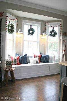 Bay window seat in kitchen decorated for Christmas
