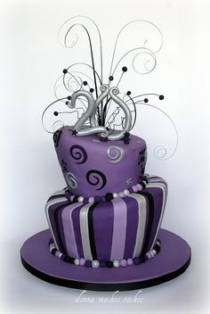 3 tiers, green centre tier, green accents on other tiers      Purple, Black and Silver Topsy Turvy Cake by donna_makes_cakes, via Flickr