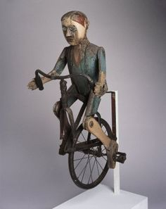 Boy riding a bicycle from the Brooklyn Museum.