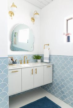 Scalloped blue tiles for the win!