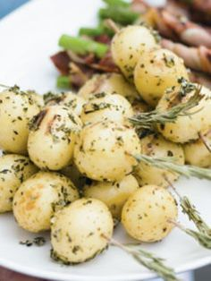 Baby potato rosemary skewers. Neat idea for a plated meal.