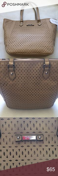 GORGEOUS Jessica Simpson Purse NEW WITH TAGS! Laser cut large tote. Snap closure at the top. Authentic Jessica Simpson. Updating pictures ASAP. Jessica Simpson Bags