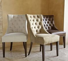French style upholstered dining chairs with studwork and buttoned