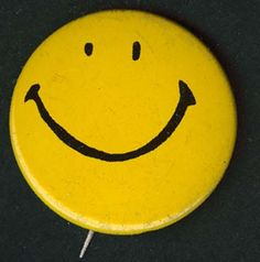 """The Original Smiley Face Button - The smiley face was a logo designed by Harvey Ball in 1963 for the State Mutual Life Assurance Company to improve employee morale. In the 1970's the smiley face achieved iconic stature when it was combined with the saying """"Have a Happy Day"""". In 1972 about 50 million smiley face buttons were sold before the craze started to die off.  Also interesting, S. Face was named """"Person of the Year"""" by Rolling Stone Magazine in 1973."""