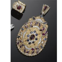 THREE-COLOUR GOLD, SAPPHIRE, RUBY AND DIAMOND PENDANT, CAZZANIGA, 1970S decorated with brilliant-cut diamonds, marquise cut sapphires and circular-cut rubies drop, oval and marquise signed Cazzaniga Rome, punch gold, within original case.