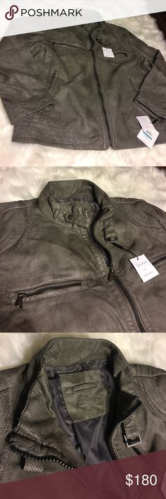 Calvin Klein Grey Washed Faux Leather Jacket XL 🍂Make An offer🍂This jacket is a washed grey jacket. (Pics look kind of green but it's NOT. It is a gray stone colored wash) Very beautiful jacket for any man. It is brand new with tags and in perfect condition!  Thank you for your interest ❤️ Happy Poshing 🎃 Calvin Klein Jackets & Coats