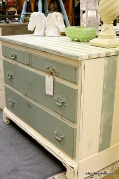 Cottage stripes painted on a small buffet. Great coastal or cottage look.