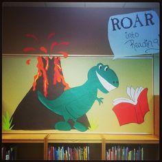 Roar into reading bulletin board. Cute T Rex board Dinosaur Bulletin Boards, Dinosaur Classroom, Reading Bulletin Boards, Bulletin Board Display, Dinosaurs Preschool, Preschool Crafts, Library Posters, Children's Library, Library Ideas