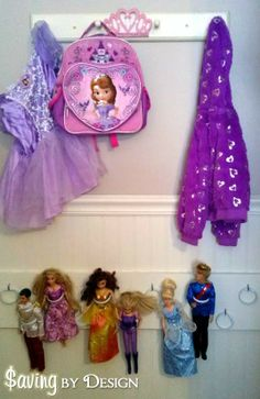 Got dolls? Take a look at this DIY Barbie Doll Organizer {Cheap & Easy!} - SavingByDesign.com