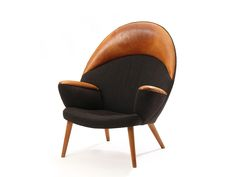 the Upholstered Peacock by Hans J. Wegner   From a unique collection of antique and modern lounge chairs at http://www.1stdibs.com/furniture/seating/lounge-chairs/