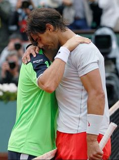 Rafael Nadal and David Ferrer at the net after Rafael Nadal captures eighth French Open crown | 2013
