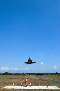 A great photo and angle of a shuttle landing.