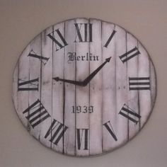 Pallet Clock.  Can see it being made with a wood wire spool also