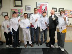 Salle Green fencers participate by showing their White Cards on 6 April 2015, the International Day of Sport for Development and Peace.  This United Nations initiative is supported by the Federation International d'Escrime to promote the role sport in promoting peace and empowering development.