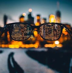 a9a0ad7008 A stunning skyline seen through glasses. Photography by Bokeh Photography