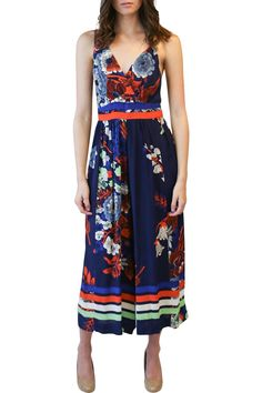 Freshen up your look for the new season by taking on the ever popular floral trend. Beautiful, vibrant colors. Surplice bodice with cropped wide-leg pant. Side pockets. Back zip.    Navy Flared Jumpsuit  by Plenty by Tracy Reese. Clothing - Jumpsuits & Rompers - Jumpsuits Texas
