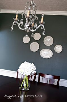 This gorgeous gray carries a blue undertone that adds amazing depth to the color. Paired with elegant white accents, Homburg Gray SW 7622 works as a perfect, deep neutral in this dining room.