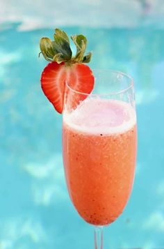 Italian Strawberry Bellini Cocktails with bubbly Proseccowhite wine, honey strawberry syrup or puree, plus an exotic touch of vanilla.