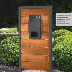 This timber letterbox boasts stylish contrasting wood panels with a premium powder coated front panel to create a modern letterbox for your front lawn. Diy Mailbox, Modern Mailbox, Timber Panelling, Wood Paneling, Home Room Design, House Design, Timber Fencing, Wrought Iron Gates, Modern Exterior