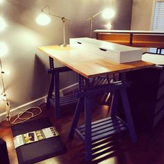 IKEA Hack Standing Desk.   EKBY shelf with drawers GERTON solid wood table top FINNVARD trestle legs  NOTE: the desk in the background is my husband's. Because he is taller he added the CAPITA brackets and LACK wall shelf to put his display on.