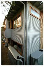 Corrugated iron cladding sections House Cladding, Metal Cladding, Wall Cladding, Facade House, Cladding Ideas, Metal Siding, External Cladding, Tin House, Casas Containers