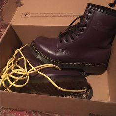 Dr marten purple boots I only wore this a handful of times and broke it in, realized it was too big for me :/ love them tho. It also comes with the yellow laces. Dr. Martens Shoes Combat & Moto Boots