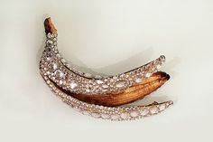 very chanel banana    no its a representation of how beauty is only skin deep you obviously dont understand the deeper meaning behind this photo of a bedazzled banana