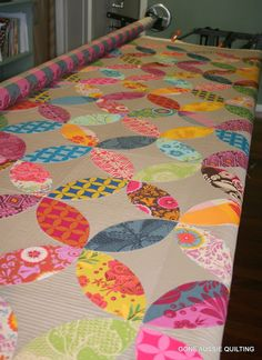 "Jeannette Bruce writes, ""The quilting on this is just a simple back and forth, I wanted to quilt the areas between the peels very heavily and to avoid quilting over the peels in order to make them pop out.  This morning I got up early to turn the quilt and quilt the other half of this and I am loving the result!"""